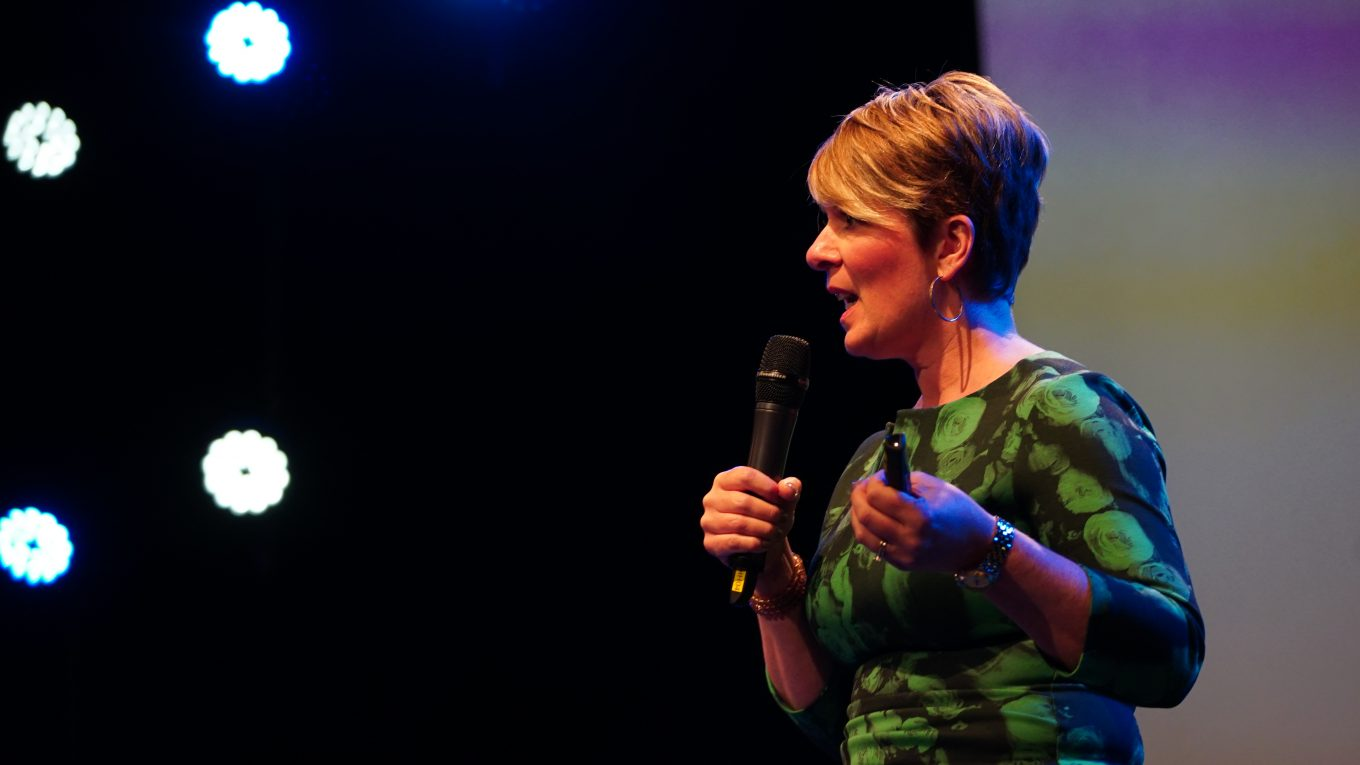 Penny Haslam Motivational Speaker speaking on stage
